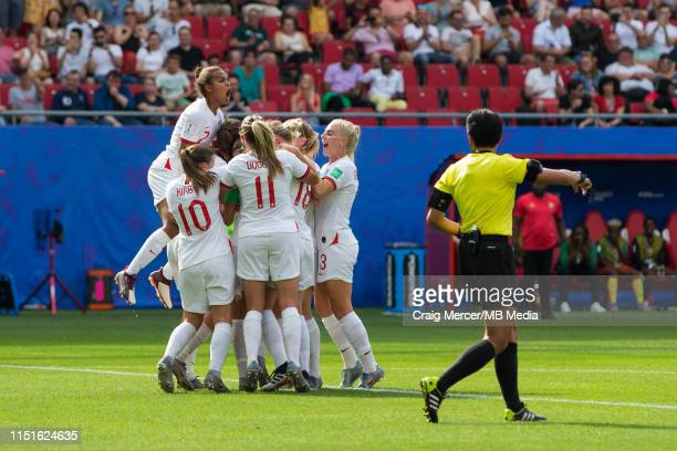 Steph Houghton of England celebrates scoring the opening goal with teammates during the 2019 FIFA Women's World Cup France Round Of 16 match between...