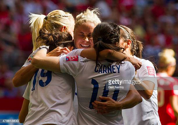Steph Houghton of England celebrates with teammates after Lucy Bronze scored against Canada during the FIFA Women's World Cup Canada 2015 Quarter...