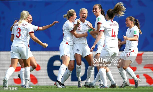 Steph Houghton of England celebrates with teammates after scoring her team's first goal during the 2019 FIFA Women's World Cup France Round Of 16...
