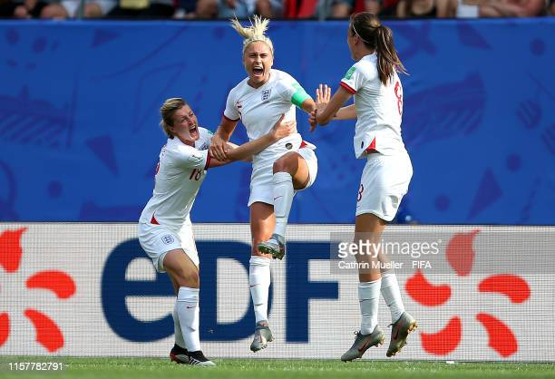 Steph Houghton of England celebrates with teammates Jill Scott and Ellen White after scoring her team's first goal during the 2019 FIFA Women's World...