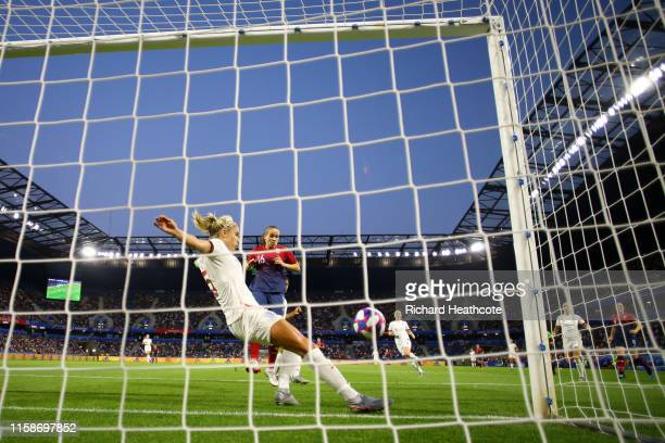 Steph Houghton of England clears the ball of the line as Guro Reiten of Norway puts pressure on herduring the 2019 FIFA Women's World Cup France...