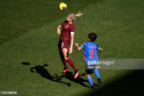 Steph Houghton of England heads the ball as Mana Iwabuchi of Japan defends during the first half in the SheBelieves Cup at Red Bull Arena on March 08...