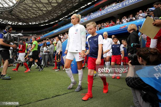 Steph Houghton of England leads her team out prior to the 2019 FIFA Women's World Cup France group D match between England and Scotland at Stade de...