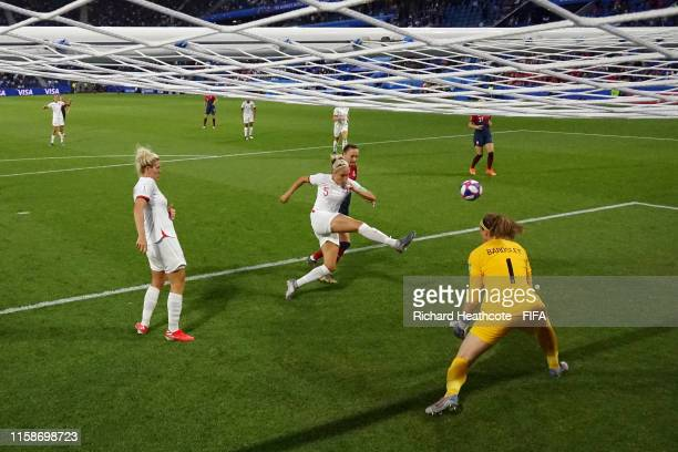 Steph Houghton of England makes a clearance under pressure from Caroline Graham Hansen of Norway during the 2019 FIFA Women's World Cup France...
