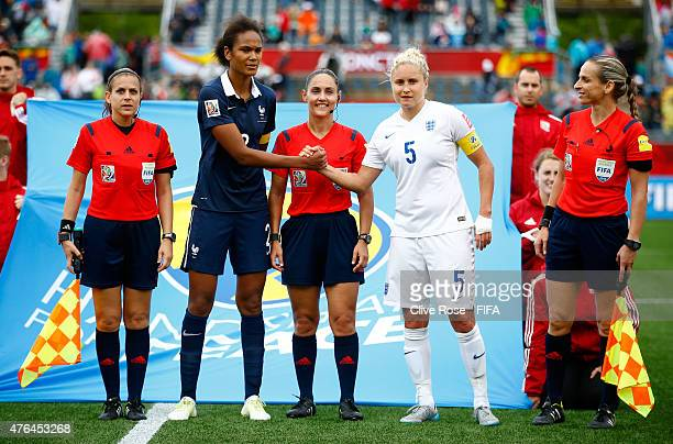 Steph Houghton of England participates in the 'handshake of peace' initiative after the FIFA Women's World Cup 2015 Group F match between France and...