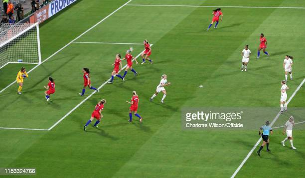 Steph Houghton of England reacts after missing a penalty whilst the USA players run to celebrate with USA goalkeeper Alyssa Naeher during the 2019...