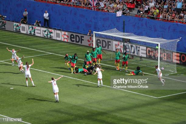Steph Houghton of England scores their 1st goal from an indirect freekick past a row of defenders on the line and celebrates during the 2019 FIFA...
