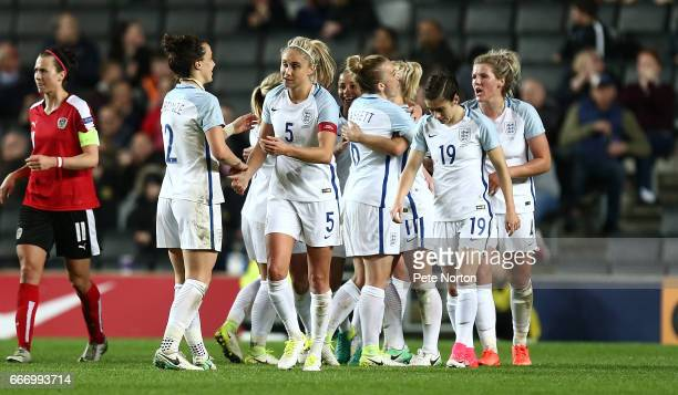 Steph Houghton of England Women is congrratulated after setting up her sides third goal during the International Friendly match between England Women...