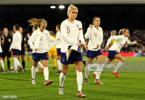 Steph Houghton of England Women takes off her jacket ahead of the International Friendly match between England Women and Australia at Craven Cottage...