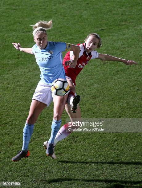 Steph Houghton of Man City and Vivianne Miedema of Arsenal battle for the ball during the WSL Continental Cup Final between Arsenal Women and...