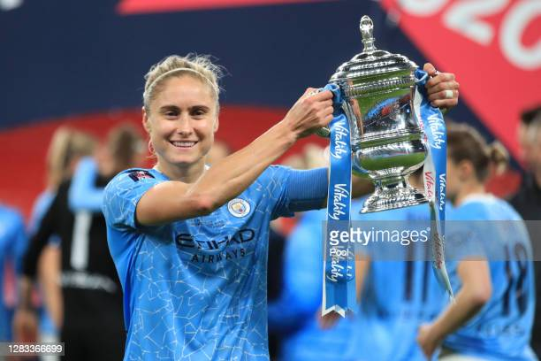 Steph Houghton of Manchester City celebrates with the Vitality Women's FA Cup Trophy following her team's victory in the Vitality Women's FA Cup...