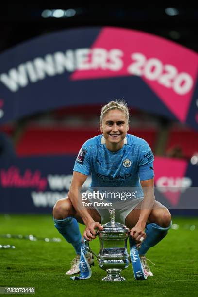 Steph Houghton of Manchester City celebrates with the Vitality Women's FA Cup Trophy following her team's victory in Vitality Women's FA Cup Final...