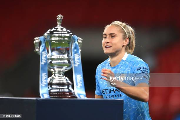 Steph Houghton of Manchester City goes to collect the Vitality Women's FA Cup Trophy following her team's victory in the Vitality Women's FA Cup...