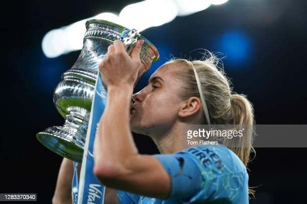 Steph Houghton of Manchester City kisses the Vitality Women's FA Cup Trophy following her team's victory in the Vitality Women's FA Cup Final match...