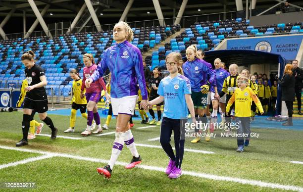 Steph Houghton of Manchester City leads out the team with a mascot during the Barclays FA Women's Super League match between Manchester City and...
