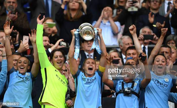 Steph Houghton of Manchester City lifts the trophy after the SSE Women's FA Cup Final between Birmingham City Ladies and Manchester City Women at...
