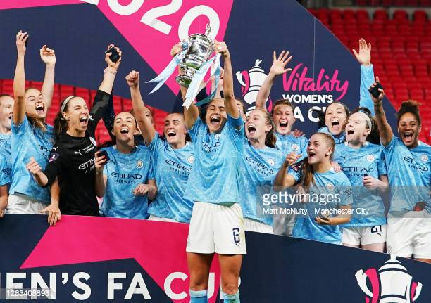 Steph Houghton of Manchester City lifts the trophy with teammates during the Vitality Women's FA Cup Final match between Everton Women and Manchester...