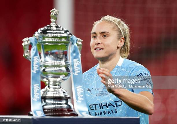 Steph Houghton of Manchester City picks up the trophy during the Vitality Women's FA Cup Final match between Everton Women and Manchester City Women...