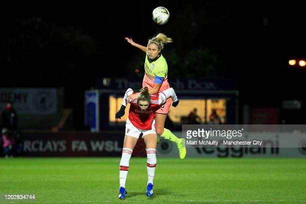 Steph Houghton of Manchester City wins a header above Vivianne Miedema of Arsenal during the FA Women's Continental League Cup SemiFinal match...