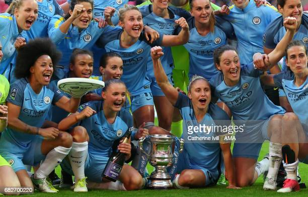 LONDON ENGLAND MAY 13 Steph Houghton of Manchester City Women celebrates with her team mates including Demi Stokes and Isobel Christiansen during the...
