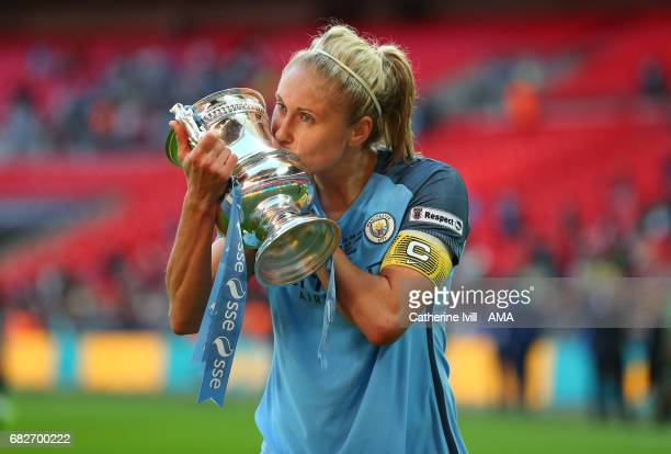LONDON ENGLAND MAY 13 Steph Houghton of Manchester City Women kisses the FA Cup trophy during the SSE Women's FA Cup Final between Birmingham City...