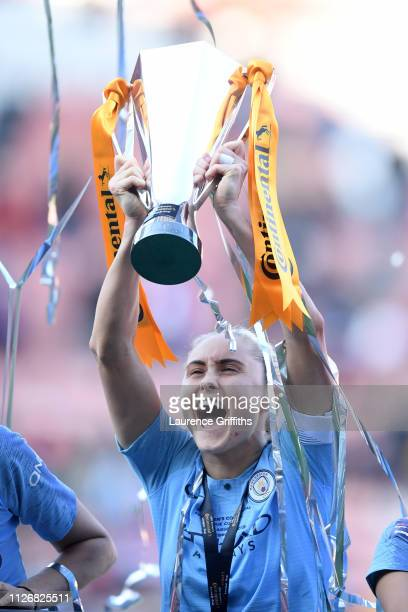 Steph Houghton of Manchester City Women lifts the trophy following the FA Women's Continental League Cup Final between Arsenal and Manchester City...