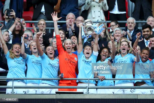Steph Houghton of Manchester City Women lifts the Women's FA Cup Trophy as her team win the Women's FA Cup Final match between Manchester City Women...