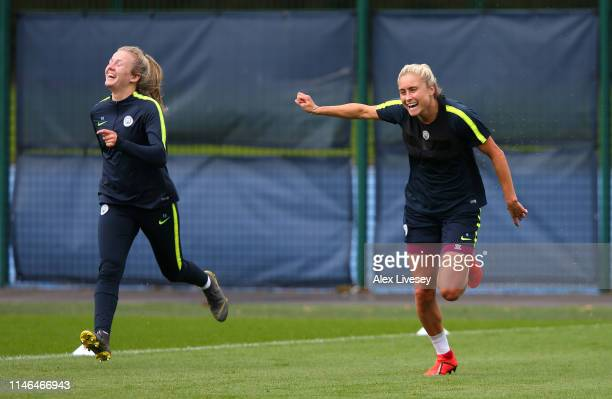 Steph Houghton of Manchester City Women races Lauren Hemp during a training session ahead of the SSE Women's FA Cup Final at the Academy Stadium on...