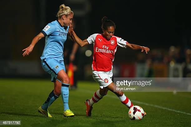 Steph Houghton of Manchester City Women tackles Rachel Yankey of Arsenal Ladies during the FA WSL Continental Cup Final between Arsenal Ladies and...