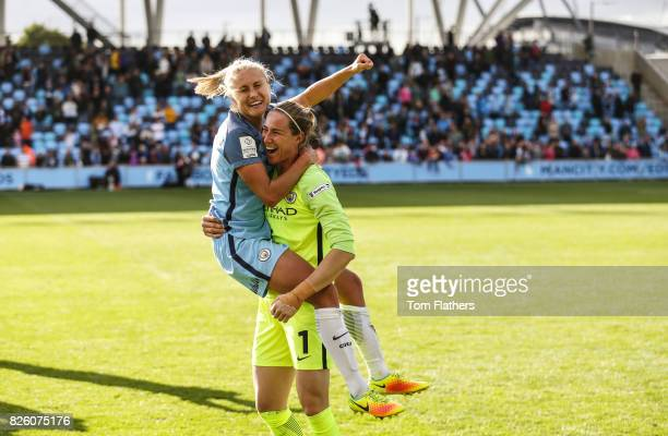 Steph Hougton and Karen Bardsley of Manchester City celebrate winning the Women's Super League