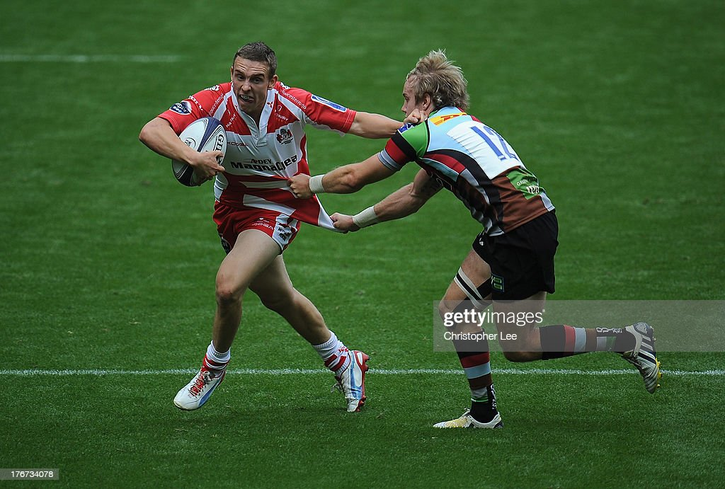 Steph Reynolds (L) of Gloucester is tackled by Charlie Walker of Harlequins during the Cup Semi Final match between Gloucester and Harlequins in the World Club 7's at Twickenham Stadium on August 18, 2013 in London, England.