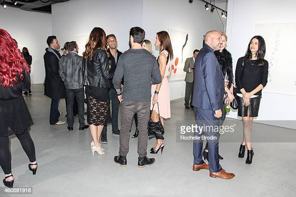Steph Sebbag Courtney McCann Taylor Reynolds and guests attend the Alison Bignon Fragments exhibtion at De Re Gallery on December 16 2014 in West...