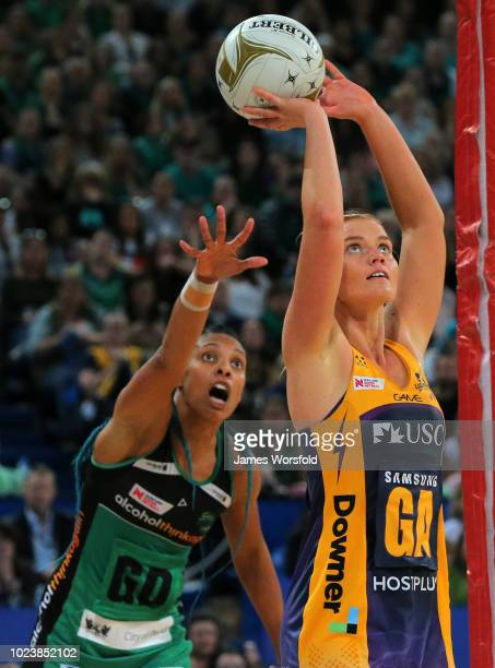 Steph Wood of the Sunshine Coast Lightning takes a shot while Stacey Francis of the West Coast Fever looks on behind her during the Super Netball...
