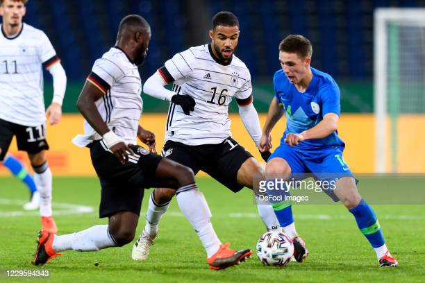 Stephan Ambrosius of Germany, Jean-Manuel Mbom of Germany and Tamar Svetlin of Slovenia battle for the ball during the International Friendly match...