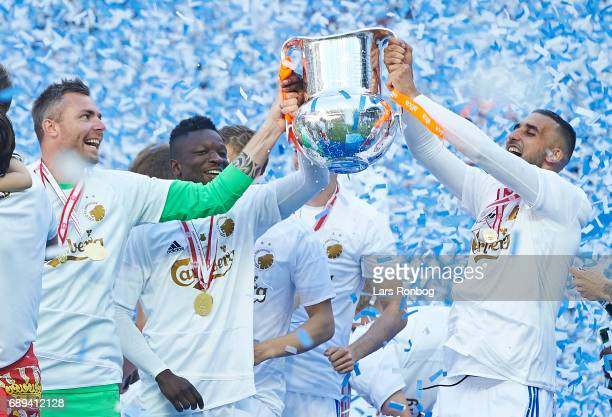 Stephan Andersen Danny Amankwaa and Youssef Toutouh of FC Copenhagen lifting the trophy as Danish Champions 2016/2017 after the Danish Alka Superliga...