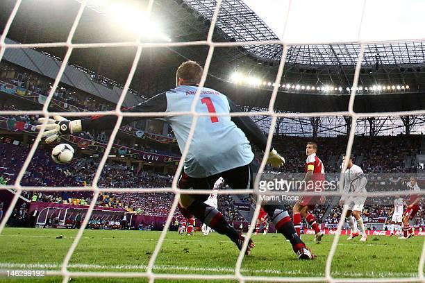 L'VIV UKRAINE JUNE 13 Stephan Andersen of Denmark fails to stop Silvestre Varela of Portugal score their third goal during the UEFA EURO 2012 group B...