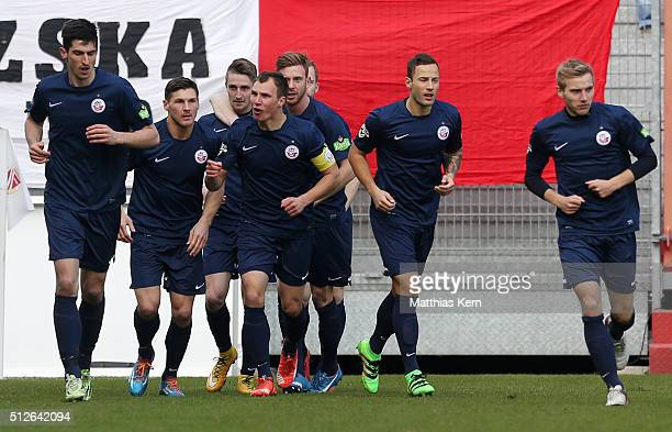 Stephan Andrist of Rostock jubilates with team mates after scoring the first goal during the third league match between FC Energie Cottbus and FC...