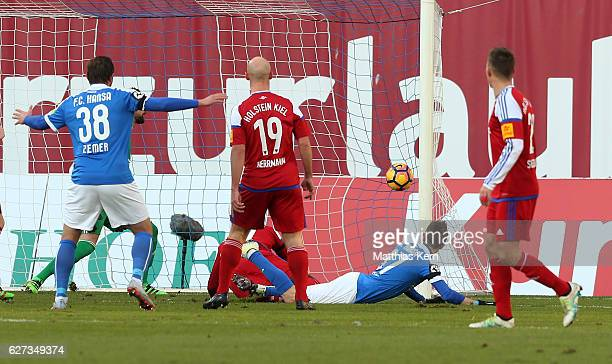Stephan Andrist of Rostock scores the first goal during the third league match between FC Hansa Rostock and Holstein Kiel at Ostseestadion on...