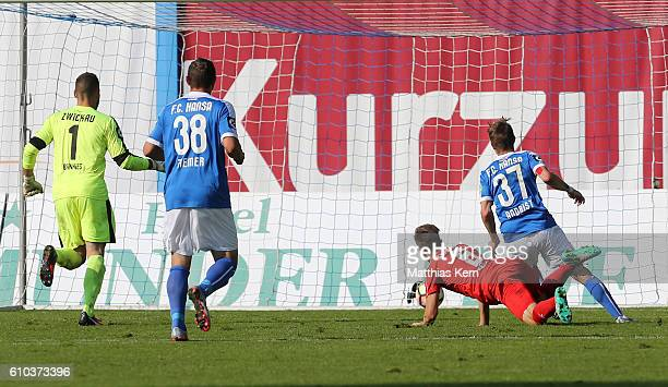 Stephan Andrist of Rostock scores the third goal during the third league match between FC Hansa Rostock and FSV Zwickau at Ostseestadion on September...