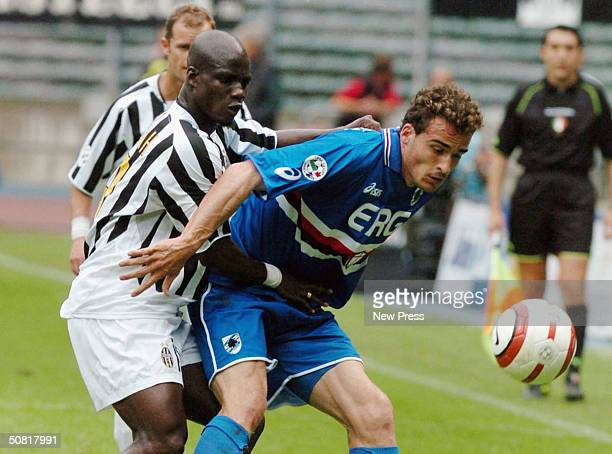 Stephan Appiah of Juventus clashes with Giacomo Cipriani of Sampdoria during the Serie A match between Juventus and Sampdoria played at the Delle...