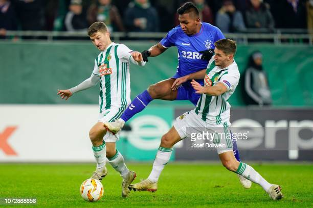 Stephan Auer of Rapid Alfredo Morelos of Rangers and Maximillian Hofmann of Rapid during the UEFA Europa League match between SK Rapid Wien v Rangers...