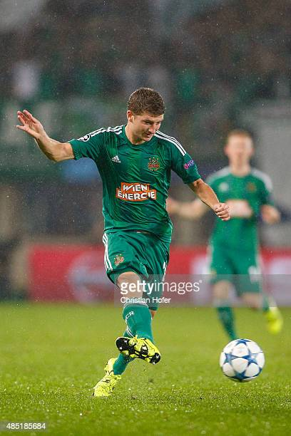 Stephan Auer of Vienna controls the ball during the UEFA Champions League Qualifying Round Play Off First Leg match between SK Rapid Vienna and FC...