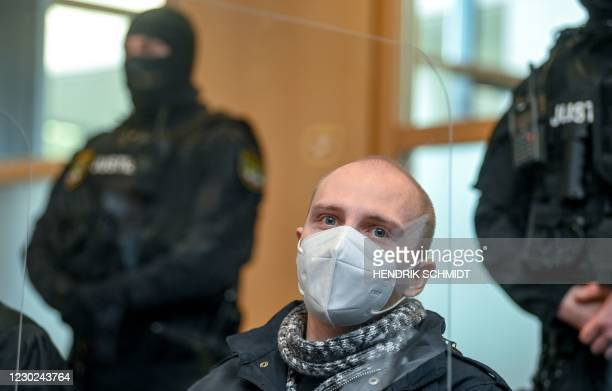 Stephan Balliet, who is accused of shooting dead two people after an attempt to storm a synagogue in Halle an der Saale, eastern Germany, waits for...