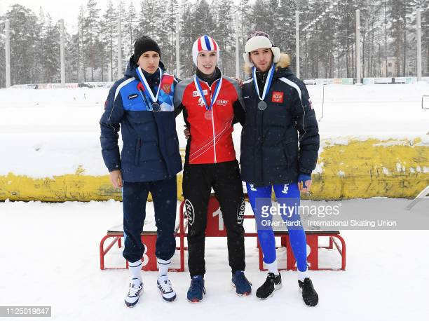 Stephan Chistiakov of Russia with the silver medal Hallgeir Engebraten of Norway with the gold medal and Daniil Aldoshkin of Russia with the bronze...