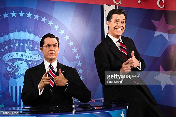 Stephan Colbert poses for photos with his wax figure at the Stephen Colbert wax figure unveiling at Madame Tussauds on November 16 2012 in Washington...