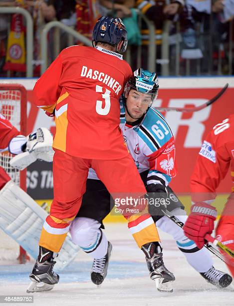 Stephan Daschner of the Duesseldorfer EG and Patrick Spannring of the Black Wings Linz fight for the puck during the game between Duesseldorfer EG...