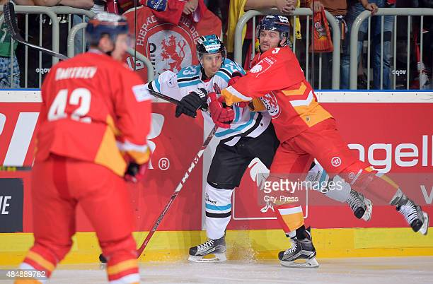 Stephan Daschner of the Duesseldorfer EG gives a Bodycheck to Fabio Hofer of the Black Wings Linz during the game between Duesseldorfer EG and Black...