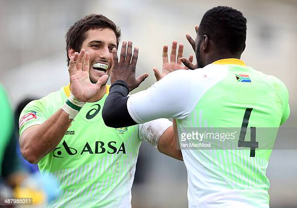 Stephan Dippenaar of South Africa celebrates with Jamba Ulengo of South Africa after his try during the game against Samoa during the IRB Glasgow...