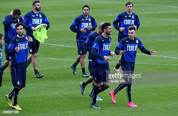 Stephan El Shaarawy and Graziano Pelle chat during the training session at Coverciano on November 11 2015 in Florence Italy
