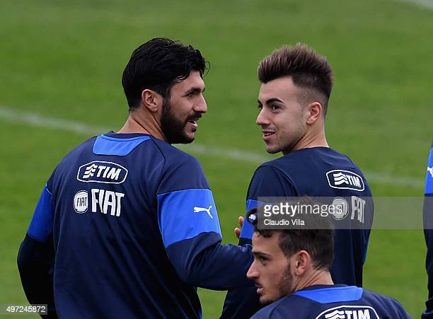 Stephan El Shaarawy and Roberto Soriano chat during the Italy training session at Coverciano on November 15 2015 in Florence Italy